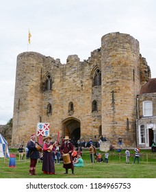 TONBRIDGE, ENGLAND - SEPTEMBER 8, 2018: Minstrels play Medieval musical instruments - hurdy gurdy, guitar and drum - at a fair in the grounds of Tonbridge Castle in Kent