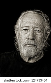 Toned black and white image of serious tough old man