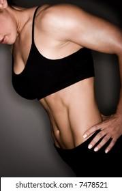 Toned female body builder