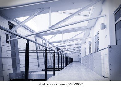 Toned image of empty corridor in modern office building