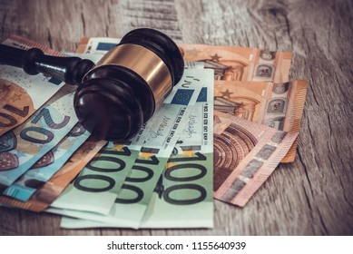 toned image - Judge's gavel on euro banknotes close up
