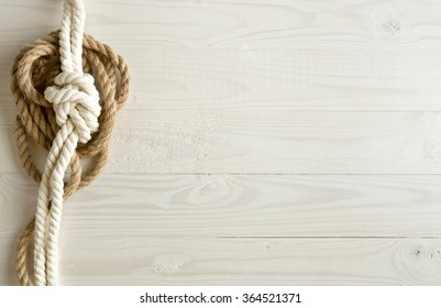 Toned image of ship ropes on white wooden background