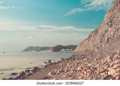 Toned image of Sukko village from the rocky shore of the Black sea in Krasnodar region, Russia.