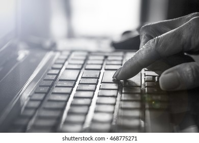 Toned photo.  A businessman or businesswoman or freelancer is using a laptop. Closeup of hand on the laptop keyboard. Concept: creative, new idea, work in the office or work outside the office.