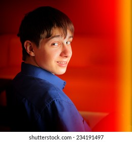 Toned photo of Happy Teenager Portrait on the Red Background