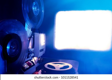 Toned Photo of Old Film Projector showing the Film in Dusk
