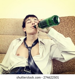 Toned Photo of Teenager drink a Beer on the Sofa at the Home