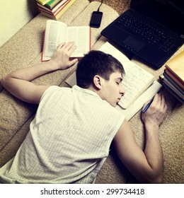 Toned Photo of Teenager sleep with the Books on the Sofa at the Home