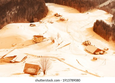 toned photography, switzerland in winter, snow in the mountains, trees, houses, top view of the ski resort town of Engelberg, sandstorm concept from Africa, Sahara