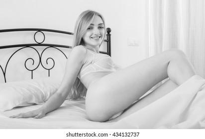 Toned portrait ofl girl in naughty semi-transparent underwear