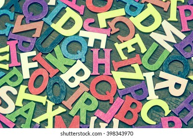 Toned Random English Wooden Multicolored Letters On  Wood Background, Close Up, Top View, Horizontal Image