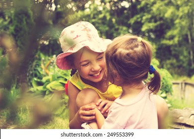 Toned Summer portrait of cute little girls