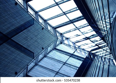 Toned tilt photo of public or office building interior with modular structures of wall and ceiling. Modern architecture with structural glazing.