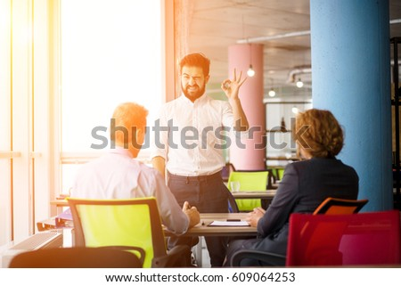 Toned of young bearded man knows how to get positive assessment to get job position. Confident handsome man communicating with employees.