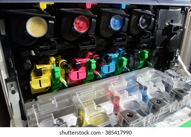 toner cartridges lined up inside the front panel of a photocopier