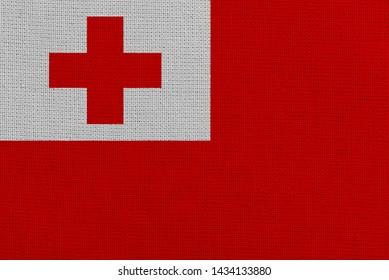 Tonga fabric flag. Patriotic background. National flag of Tonga