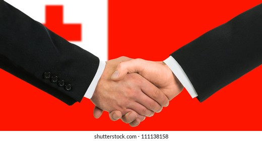 The Tonga flag and business handshake