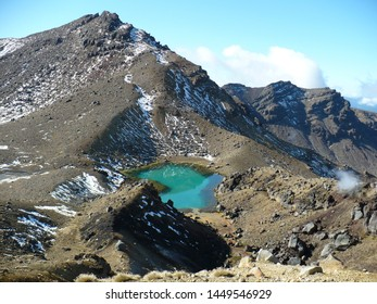 The Tongariro Alpine Crossing in Tongariro National Park is a very popular tramping track in New Zealand. The photo shows captivating Emerald lakes during this hike.