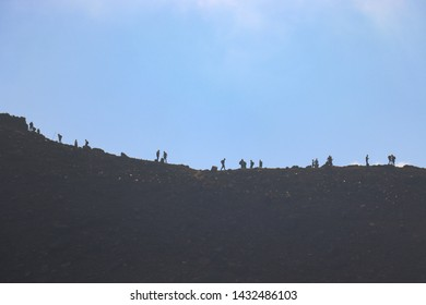 Tongariro National Park, NEW ZEALAND -18 MAR 2019:mountain climbers walking on the Mount Ngauruhoe in the TONGARIRO ALPINE CROSSING in Tongariro National Park under blue sky with fog in north island.