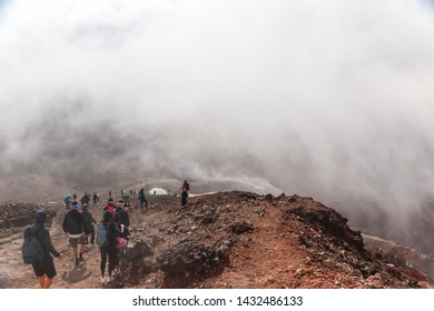 Tongariro National Park, NEW ZEALAND -18 MAR 2019: New Zealand popular tourist hiking hike in Tongariro Alpine Crossing National Park. Many hikers walking on famous destination in NZ