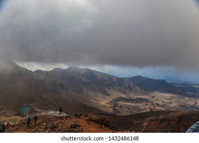 Tongariro National Park, NEW ZEALAND -18 MAR 2019:View of Emerald lakes from famous Tongariro Alpine Crossing hike with clouds above, North Island of New Zealand
