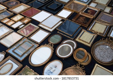 TONGEREN, BELGIUM - SEPTEMBER 13 2020: Older round, square, oval and rectangular photo and picture frames and mirrors for sale on an antique market in Tongeren, Belgium