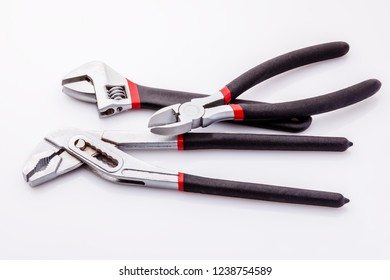 Tongs, tongs with flat, clammy ends on a white background. Long nasal and diagonal cutters. With black rubber on the handle, it becomes more comfortable.