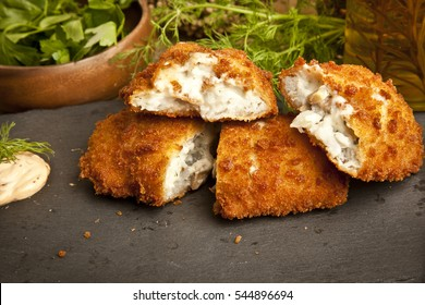 Tongue Fish fried with shrimp and mushroom stuffed on concept stone plate and wooden concept background