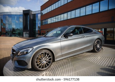 TONGWELL, MILTON KEYNES, ENGLAND - MARCH 8, 2017: Mercedes C Class coupe on display at Mercedes-Benz Head Office in UK.The Mercedes-Benz C-Class is a line of executive cars produced by Daimler AG