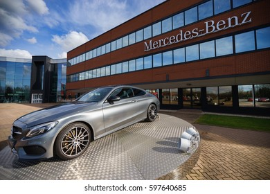 TONGWELL, MILTON KEYNES, ENGLAND - MARCH 8, 2017: Mercedes C Class on display at Mercedes-Benz Head Office in UK.The Mercedes-Benz C-Class is a line of compact executive cars produced by Daimler AG