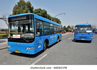 TONGXIANG, CHINA - MARCH 25, 2016: Blue public buses at Tongxiang Railway Station on March 25, 2016 in Tongxiang, China. Tongxiang City is a county-level city in northern Zhejiang Province, China.