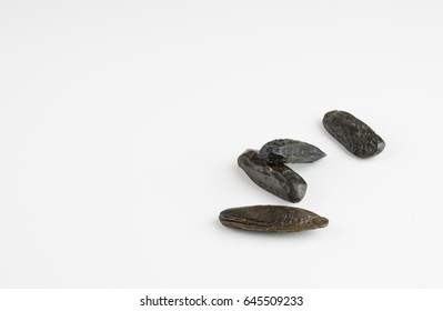 Tonka beans on white background, copy space