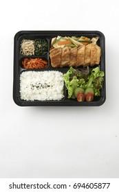 Tonkatsu bento set on white background.