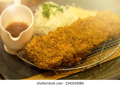 Tonkatsu is a deep fried pork cutlet in Japanese food which come with Tonkatsu sauce in a meal