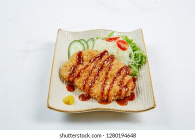 Tonkatsu dish with vegetable on white background