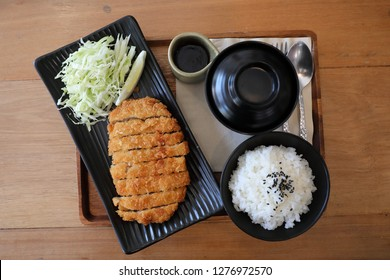 Tonkatsu fried pork cutlet with rice and soup on wooden table Japanese food