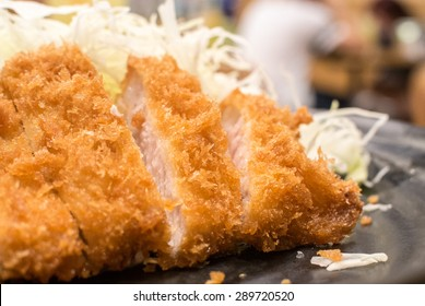 Tonkatsu serve with slice cabbage. Deep Fires pork loin. Most favorites Japanese food.  made by pork lion with bread crumb. deep fry to golden brown colour