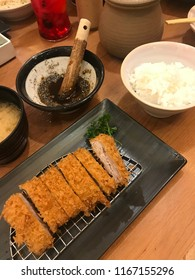 """Tonkatsu set"" The fried pork in Japanese style serve with sesame and tonkatsu sauce rice and miso soup."