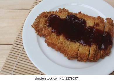Tonkatsu topped with sauce, Japanese style fried pork.