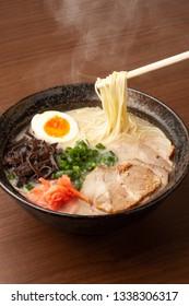 Tonkotsu Ramen  Ramen in white, milky, pork based soup.