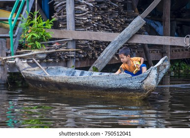 TONLE SAP , CAMBODIA - OCT 18 : Cambodian child in Tonle sap lake Cambodia on October 18 2017. Tonle sap It is the largest lake in South East Asia