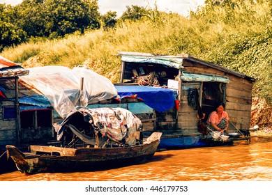 Tonle Sap Lake Siem Reap, Cambodia - July 13, 2013: Cambodian people live on Tonle Sap Lake in Siem Reap, Cambodia. Unidentified people in a Floating village on the Tonle Sap Lake