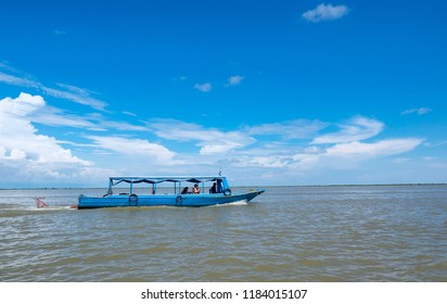 Tonle sap lake ,Siem Reap/Cambodia-September 14 2018:Unidentified tourists travel on boat at Tonle sap lake.