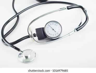 tonometer and phonendoscope on white background, copy space
