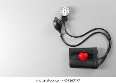 Tonometer with red heart on grey table
