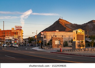 TONOPAH, NEVADA, UNITED STATES - SEPTEMBER 18, 2019. Sunset down main street (Highway 95) featuring historic downtown Mizpah Hotel and Welcome to Tonopah Sign.
