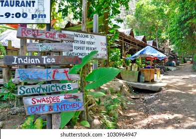Tonsai, Krabi province, Thailand - April 24, 2017. Hyppie style wood information signs in a footpath at Tonsai village, between Ao Nang and Railay.