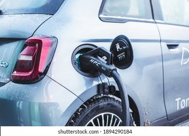 Tonsberg, Norway - January 13, 2021: silver Fiat 500 electric is a new compact electric car. New car on a charging station during