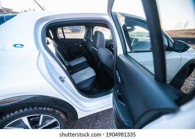 Tonsberg, Norway - January 23, 2021: pearl white  All-electric motor car Peugeot e-208 GT  is a new compact electric car. New car on a charging station