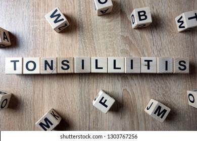 Tonsillitis word from wooden blocks on desk
